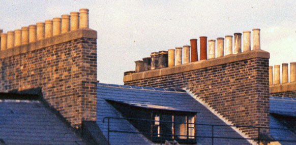 Row Of Chimney Pots without Anti-downdraught Chimney Cowls